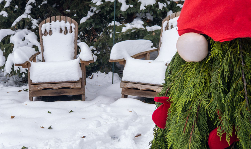 holiday gnome made of evergreens outside