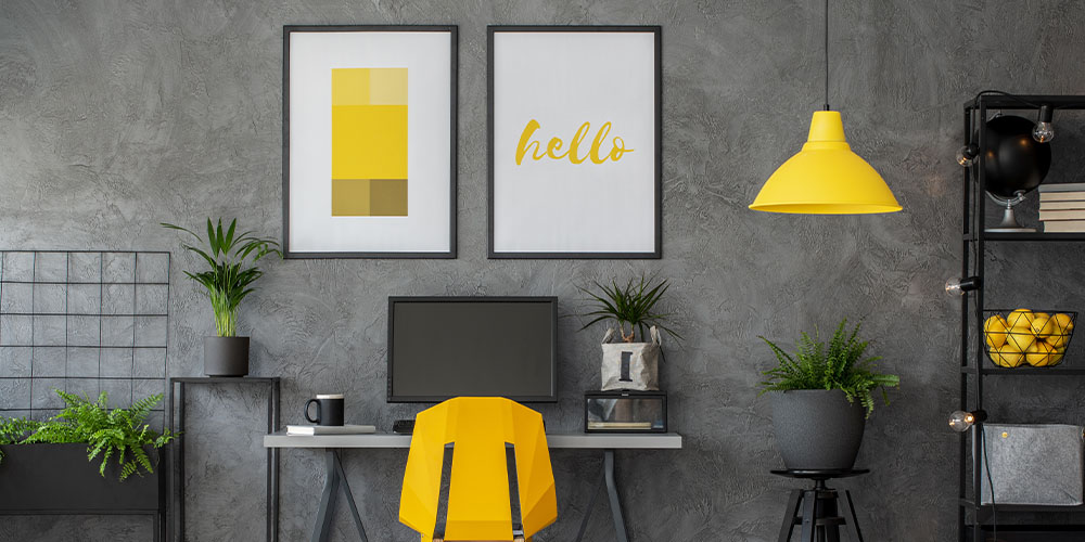 Pantone colors of the year yellow and grey office with houseplants